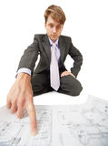 Engineer points a finger details on drawing Stock Photography