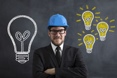 Engineer. Posing Front Of The Blackboard Royalty Free Stock Images