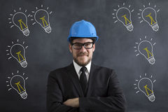 Engineer. Posing Front Of The Blackboard Royalty Free Stock Photo
