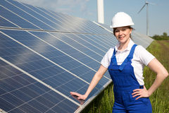 Engineer posing with solar energy panels Royalty Free Stock Image