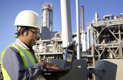 Engineer power and energy. Using laptop on location site Stock Photography
