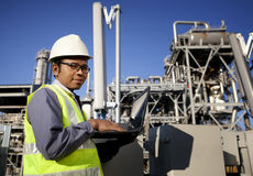 Engineer power and energy. Using laptop on location site Stock Photos