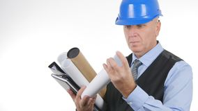 Engineer Preparing Plans and Projects for a Meeting royalty free stock images