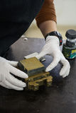 Engineer preparing a soil sample in a mold for direct shear laboratory test Stock Image