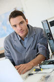 Engineer proceeding to data recovery from disc Royalty Free Stock Image