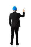 Engineer in protective helmet pointing up. Royalty Free Stock Images