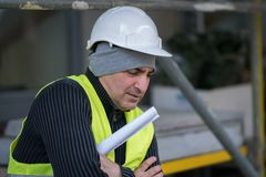 Engineer with protective workwear freezing outdoors Royalty Free Stock Photo