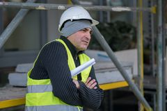 Engineer with protective workwear freezing outdoors Stock Photo