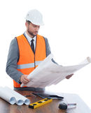 Engineer reading architecture plan of building. Stock Image