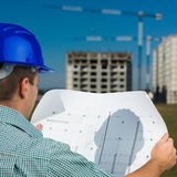 Engineer reading construction plan Stock Photos