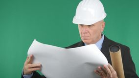 Engineer Reading a Construction Plan with Green Screen in Background stock photo