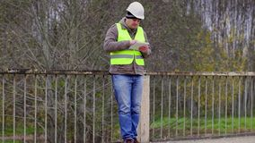 Engineer reading information in tablet PC stock footage