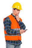 Engineer reading message at smart phone. Royalty Free Stock Photos