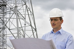 Engineer reading a plan Stock Photo