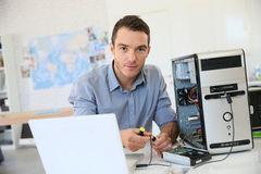 Engineer recovering data from hard drive Royalty Free Stock Images