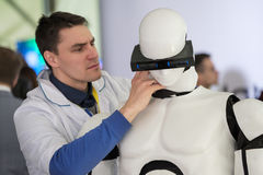 Engineer repair the robot at Startup Village Stock Image