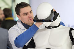 Engineer repair the robot at Startup Village Stock Photography