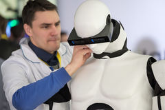 Engineer repair the robot at Startup Village Royalty Free Stock Photography