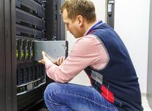 Engineer repair server. Young man, IT engineer repair server in the data center Royalty Free Stock Image