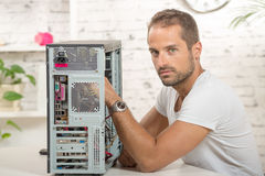 Engineer repaired a computer Stock Photo