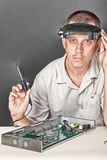 Engineer repairing circuit board Royalty Free Stock Images
