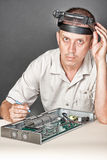 Engineer repairing circuit board Royalty Free Stock Photo