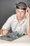 Engineer repairing circuit board Royalty Free Stock Photo