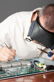 Engineer repairing circuit board Royalty Free Stock Photos