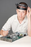Engineer repairing circuit board. In computer equipment Stock Image