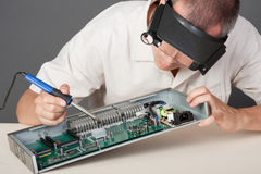 Engineer repairing circuit board. In computer equipment Royalty Free Stock Photography