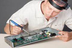 Engineer repairing circuit board Stock Photos