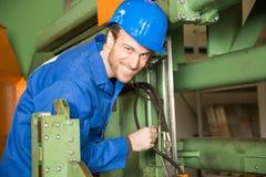 Engineer repairing a machine Stock Image
