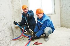 Engineer repairmen installing heating system Royalty Free Stock Image