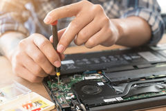 The engineer repairs the laptop (pc, computer) and the motherboa Royalty Free Stock Image