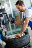 Engineer  replace tire on wheel Stock Image