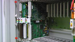 IT engineer replaces the bad card in the rack stock video footage