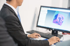 An engineer review his 3d modeling works. 1 Stock Photo