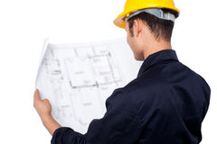 Engineer reviewing blueprint Royalty Free Stock Images