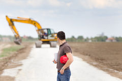 Engineer on road construction site Stock Photo