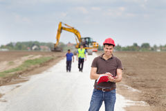 Engineer on road construction site Stock Photos