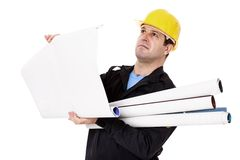 Engineer with rolls of paper in hand studies Royalty Free Stock Photography