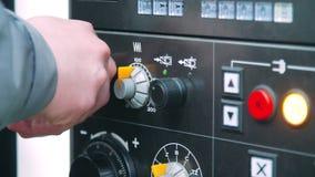 Engineer rotating adjustment knob on industrial machine. Engineer working stock video footage