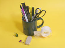 Engineer's Desk Set. Coffee cup with pens, pencils, other desk tools Stock Image