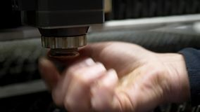 Engineer`s hand adjusts CNC laser machine for cutting metal. Plate on industrial manufacture stock footage