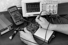 Engineer's hands holding probes Stock Image