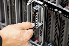 IT Engineer`s Hands Repairing Server At Data Center Royalty Free Stock Photography