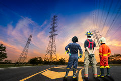 Engineer safety survey of electricity pylon. Engineer safety survey of the electricity pylon on sunrise time Royalty Free Stock Photography