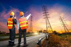 Engineer safety survey of electricity pylon. Engineer safety survey of the electricity pylon on sunrise time Stock Photography