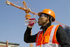Engineer drinking water Stock Images