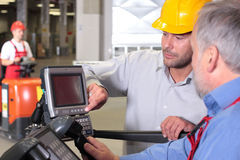 Engineer and senior worker at control panel Royalty Free Stock Images